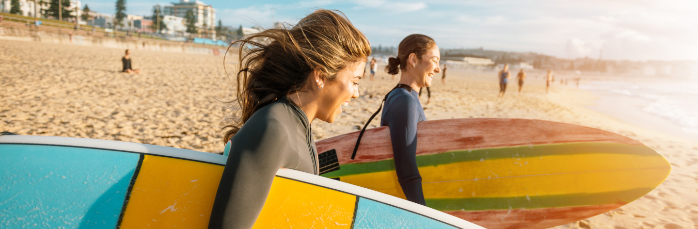 Female Surfers Rushing To Catch A Waves