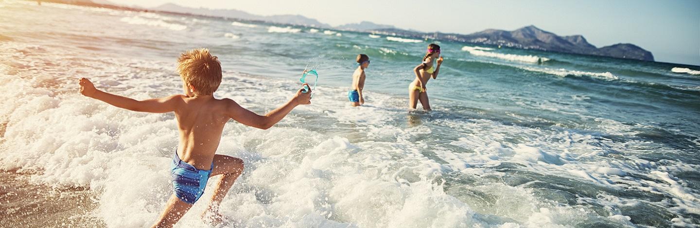 Summer Vacations Kids Playing At Sea